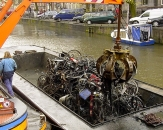 48-clearing-discarded-bicycles-from-the-canals-in-amsterdam