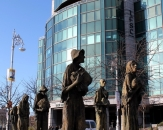 007-custom-house-quay-the-memorial-titled-famine-presents-a-group-of-famine-refugees-cast-in-bron
