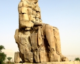 057-one-of-the-colossi-of-memnon-pharaoh-amenhotep-mortuary-temple-luxor-egypt